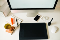 Work desk top view with computer, coffee, smart phone, tablet, n. White  desk top view with computer, coffee, smart phone, tablet, notebook, mouse Royalty Free Stock Photography