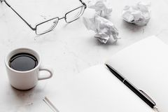 Work desk of writer with notebook, glasses, coffee on white background mock up. Work desk of writer with notebook, glasses, coffee on white desk background mock royalty free stock images
