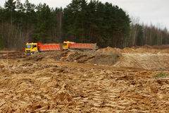 Work of digging ground and machines truck Royalty Free Stock Photos