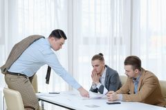 Work dismissal boss offer resign papers employee. Work dismissal and voluntary discharge. boss offering to sign resign papers to delinquent employees royalty free stock photo