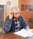 Work with documents. Man  sitting at work with documents  at home Royalty Free Stock Photo