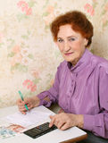 Work with documents. The woman fills forms separately on a white background Royalty Free Stock Images
