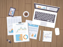 Work with documents. Workflow concept. Accounting. Analysis. Forms with charts, graphs, leptop with information on the screen, notebook, phone, desk Royalty Free Stock Photos
