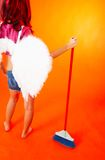 Work is done.. Cleaning Angel has finished her work. Shot of wings and broom Royalty Free Stock Image