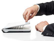 Work done. Businessman closing laptop after work is done stock photography