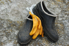 Rubber Gardening Boots and Gloves Royalty Free Stock Images
