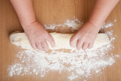 Work the dough on a floured table Royalty Free Stock Photos