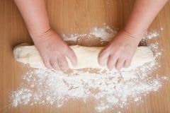 Work the dough on a floured table Royalty Free Stock Photos