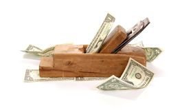 Work and earn. Old wood the planer and banknotes Royalty Free Stock Photography
