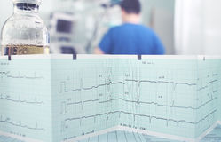 Work and ecg paper. Worker, bottle and ecg paper royalty free stock image