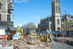 Work on Edinburgh tram lines continues. Work continues installing tramlines down Princes Street Edinburgh causing severe traffic disruption Royalty Free Stock Photos
