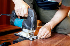 Work with an electric jigsaw. Royalty Free Stock Image