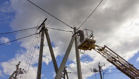 Work on electric post power pole Electrician lineman repairman worker at climbing Stock Images