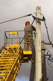 Work on electric post power pole Electrician lineman repairman worker at climbing Stock Photos