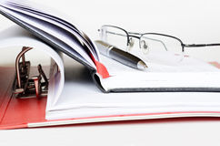 Work environment. Pen and glasses on an opened diary Stock Images