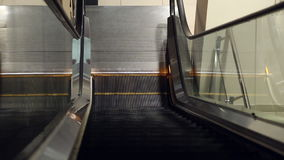 The work of the escalator in the mall. The stairs are moving up stock footage
