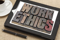 Work ethics on digital tablet Stock Photography