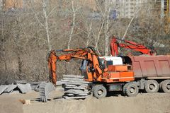 Excavating machine on construction site. Work of excavating machine on building construction site stock photography