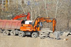 Excavating machine on construction site. Work of excavating machine on building construction site royalty free stock photos