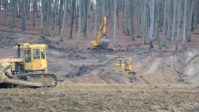 UKRAINE LVIV December 29th 2018. Work of excavators and bulldozers on the construction site. Ground alignment. Work of excavators and bulldozers on the stock footage