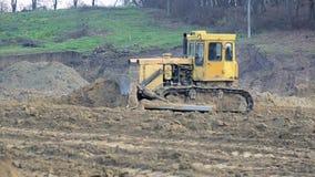 UKRAINE LVIV December 29th 2018. Work of excavators and bulldozers on the construction site. Ground alignment. Work of excavators and bulldozers on the stock video
