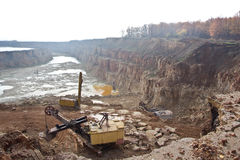 Work of excavators on limestone mining in a quarry Royalty Free Stock Photography