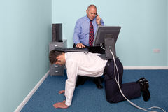 Work experience. Photo of a businessmen using a work experience employee for his desk royalty free stock photography