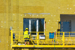 Work on the external walls of glass wool insulation and plaster Stock Image