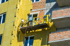 Work on the external walls of glass wool insulation and plaster Royalty Free Stock Images