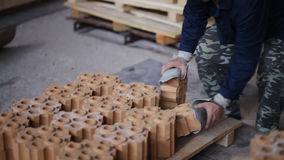 Work on the factory floor packs products. factory workers adds refractory bricks for further packaging. stock video footage