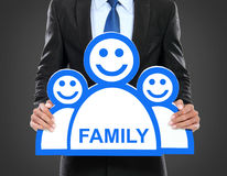 Work and family concept. Businessman holding a symbol of people, work and family concept Royalty Free Stock Image