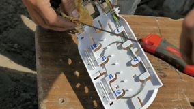 Work with fiber optic. Clutch stock photo
