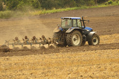 Work in the field plowing Stock Photos