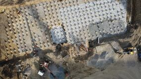 Work on the filling of the foundation at the construction of a new residential complex.