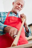 Work on fingerboard at luthier`s shop. By guitar maker royalty free stock photo