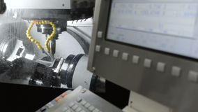 Work five-axis milling machine. Horizontal panning from the control panel to the work area stock video footage