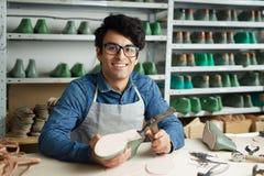 Work of footwear repairman royalty free stock photography