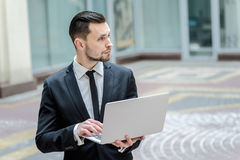 Work in full swing. Successful businessman standing in the stree Stock Images