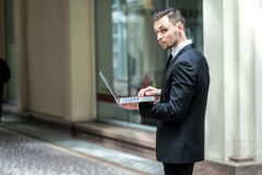 Work in full swing. Successful businessman standing in the stree Stock Photo