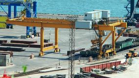Work of gantry crane at sea port stock video