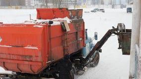 Work the garbage cars in winter. Garbage transport car loading itself. 4K stock video
