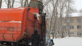 Work the garbage cars in winter. Garbage transport car loading itself. 4K stock video footage