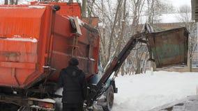 Work the garbage cars in winter. Garbage transport car loading itself. 4K stock footage