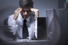 This work gives him headaches Stock Photos