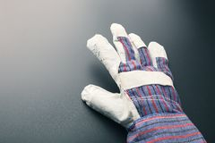 Work glove against grey Stock Photo