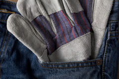 Work Glove in Blue Jean Pocket Royalty Free Stock Photos
