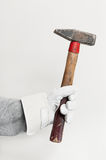 Work glove holding hammer Royalty Free Stock Photo