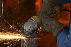 Work glove spark. A close picture of a sparks on grinded steel Stock Images