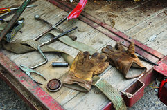 Work Gloves. Tools and work gloves on a trailor Stock Images