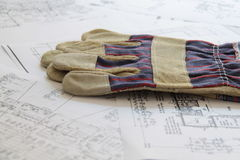 Work gloves and blueprints Stock Photo